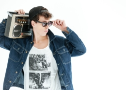 young man with boombox and sunglasses